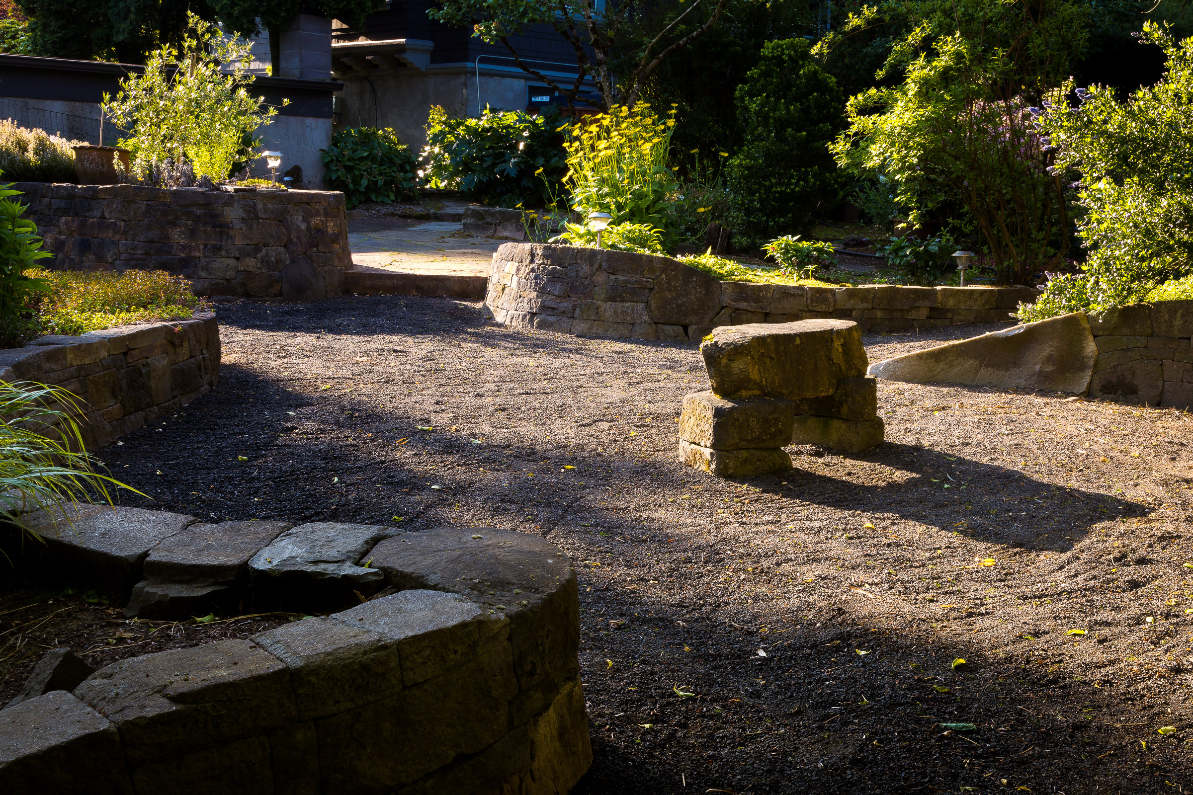 Eric Contey Stonework - DeGarmo patio at sunrise, with bench, walls, and stairs