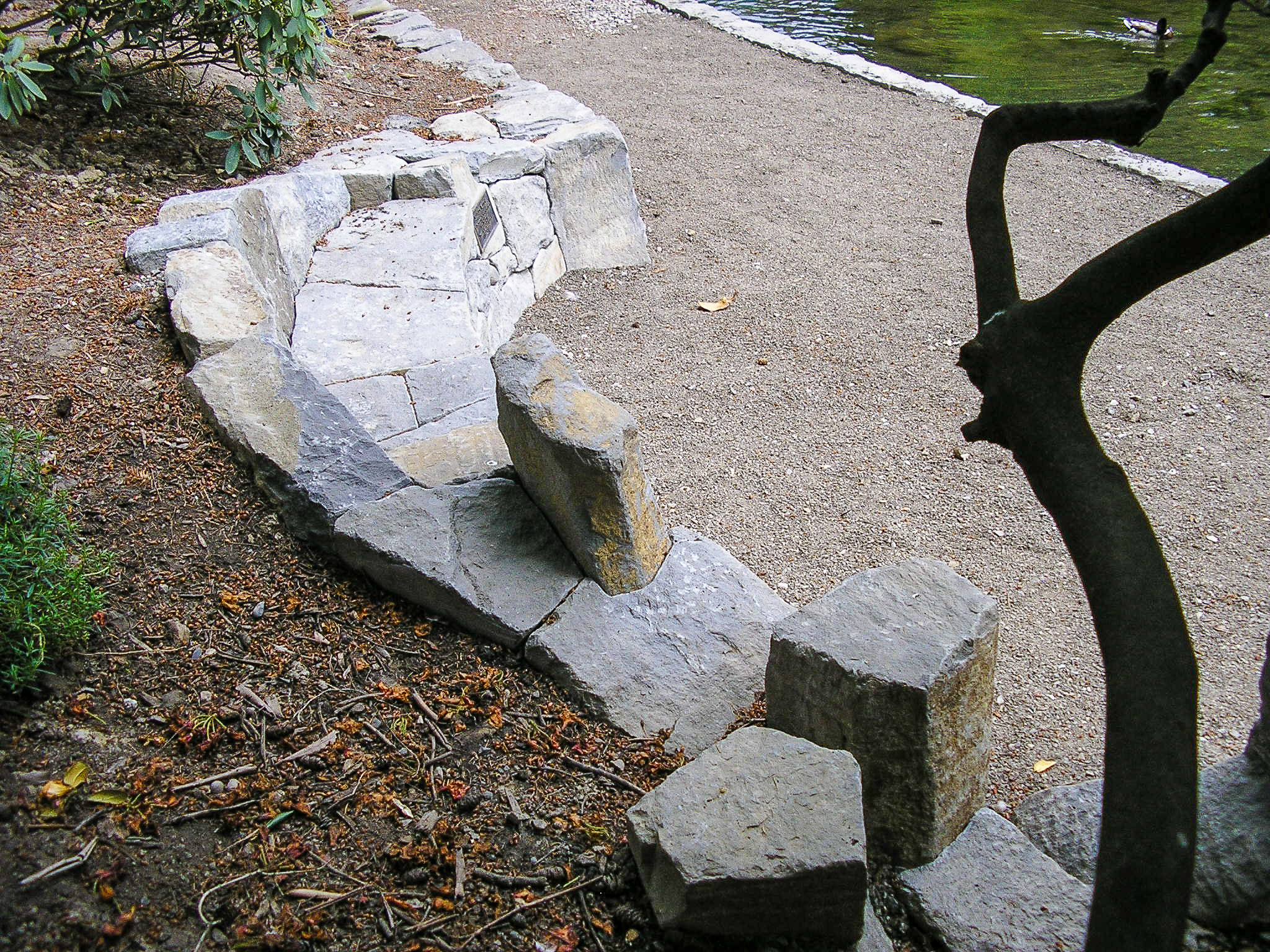 Eric Contey Stonework – Memorial viewing bench at the Rhododendron Gardens, Portland, OR